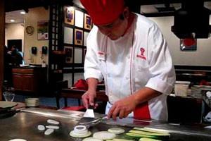 Chef prepares dinner at Benihana